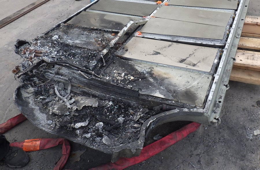 WASHINGTON (Dec. 19, 2019) — The front of a 400-VDC, 85-kWh lithium-ion battery damaged in the May 8, 2018 crash of a Tesla Model S on Florida state Route A1A, Ft. Lauderdale, Florida, is seen in this photo taken June 7, 2019, at a tow yard in Ft. Lauderdale. NTSB Photo by Tim Cunningham