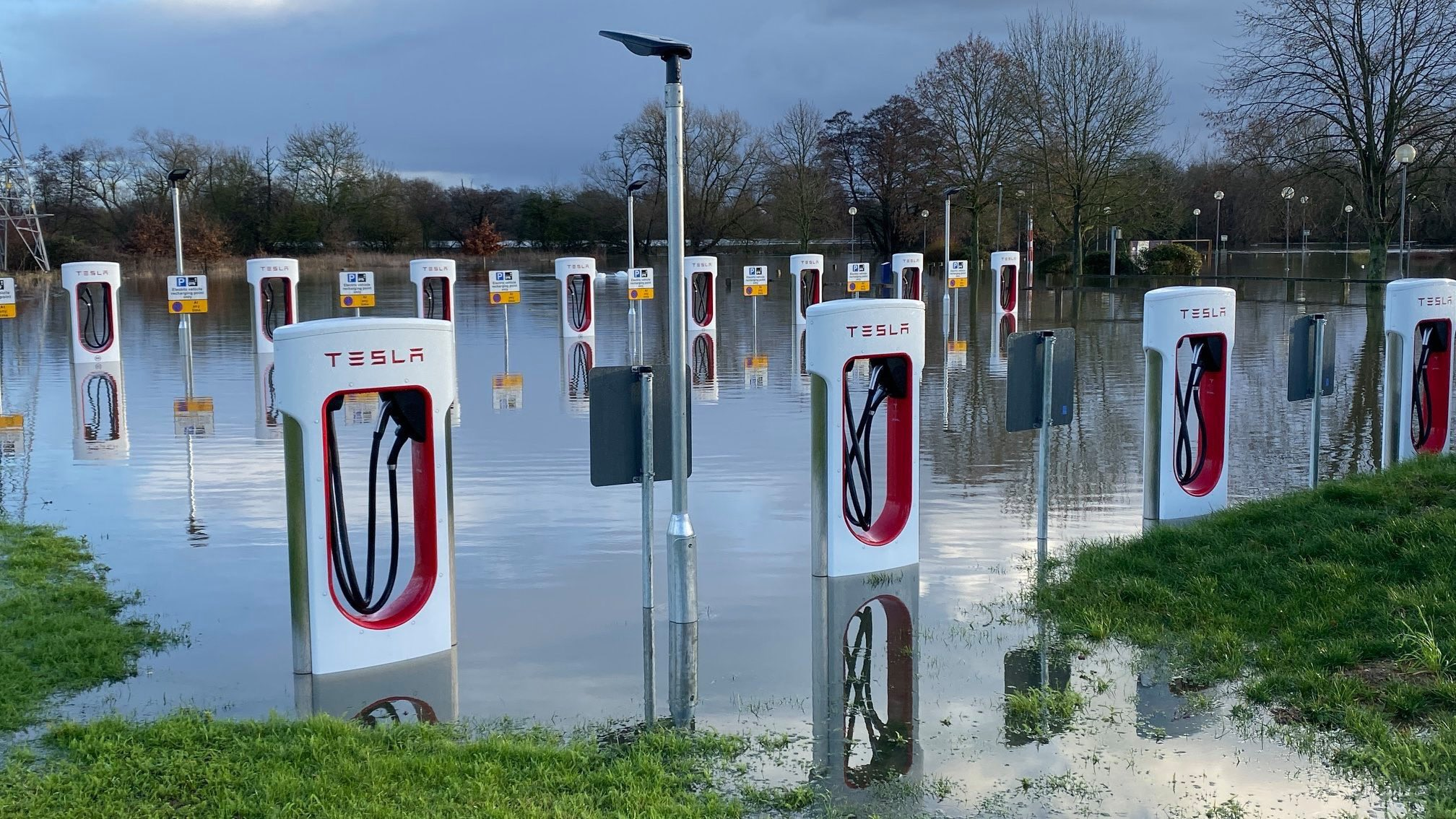 """Megan Baynes on Twitter: """"Possibly one of the most striking pictures of the  flooding I've been sent — the Tesla electric vehicle stations in Wokingham  are now underwater. I feel like there"""