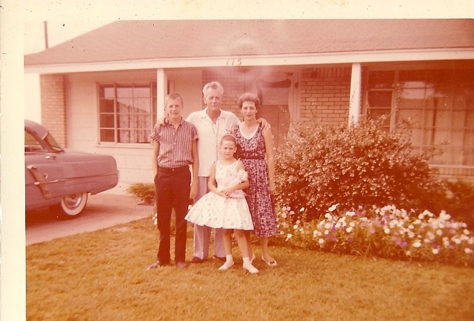 Elizabeth Warren stands with her family as a young girl.