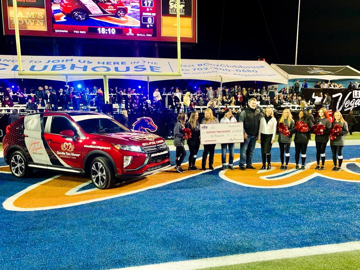 "Mitsubishi Motors and Ally Financial present a 2020 Mitsubishi Eclipse Cross ""Community Utility Vehicle"" and $10,000 to Nikki and Tony Berti, founders of the Goodie Two Shoes Foundation, which provides shoes and socks to disadvantaged children in Southern Nevada. #MMLVBowl"