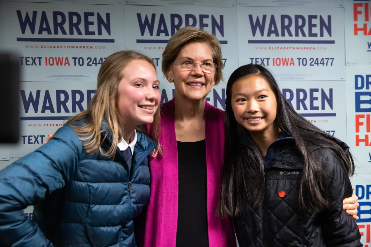Elizabeth Warren takes a photo with grassroots supporters.