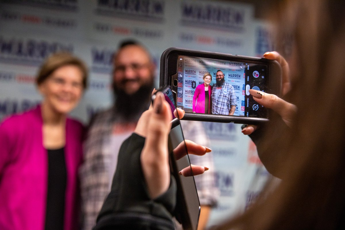 Elizabeth Warren takes a photo with a grassroots supporter.