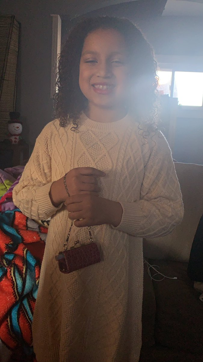 Bella channeling major @lizzo energy for family pictures with her tiny bag #belleoftheball