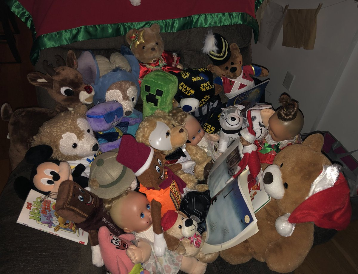 "Yearly tradition: our elf on the shelf reads ""t'was the night before Christmas"" to all his pals. his biggest audience yet as I wonder if it'll happen next year🤔 😪#wheredoesthetimego #howareyouelevenready #duffythedisneybear #magicnurserydolls @PhantomOpera @chocolateworld"