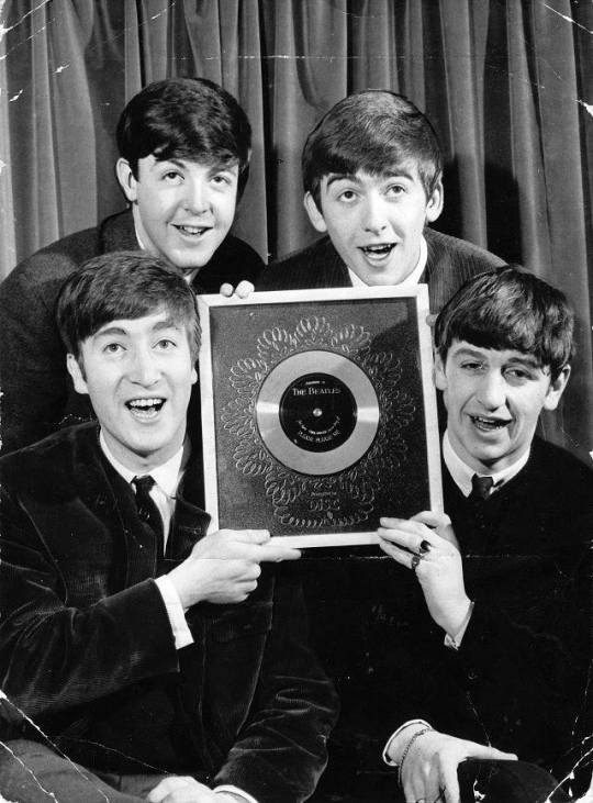 #TheBeatles posing with their golden disc for Please Please Me, 1963