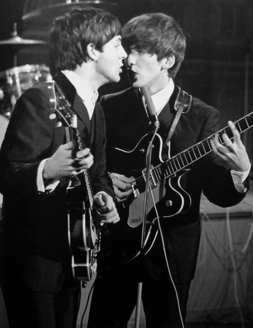 Paul and George harmonizing on stage in 1963 #TheBeatles