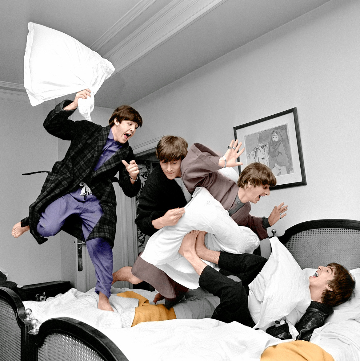 #TheBeatles having fun with a pillow fight in their hotel room in Paris, January 1964