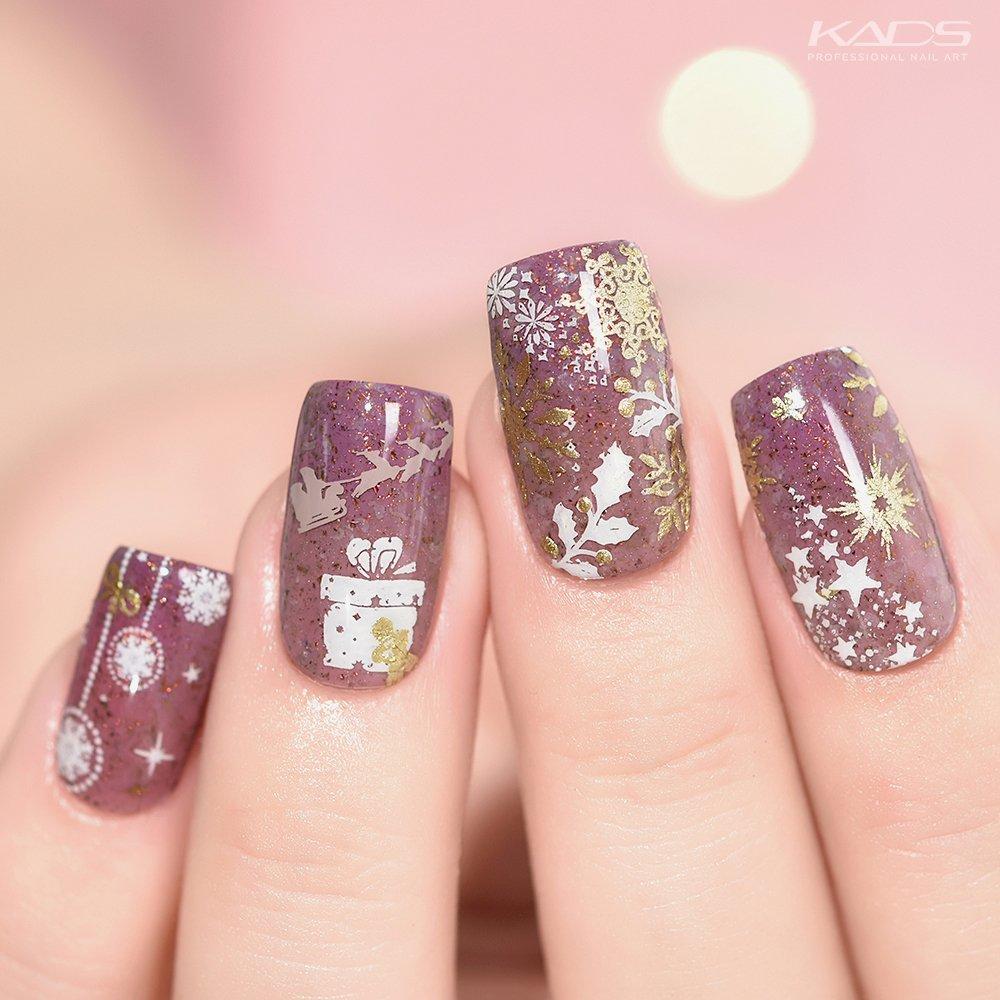 Snowflake KADS stamping plate · Christmas 018· #nails #kads #kadsnailart #nailart #nailfashion #nailwork #naildesigns #nailplates #kadschristmas #kadschristmas018 #nailpolish #snownails #christmasnails #christmasnailart #purplenails #festivalnails #snowflakenails pic.twitter.com/oGRSU5p6XA