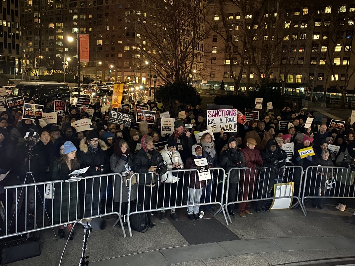 Hundreds here in the freezing cold in NYC to demand #NoWarWithIran!