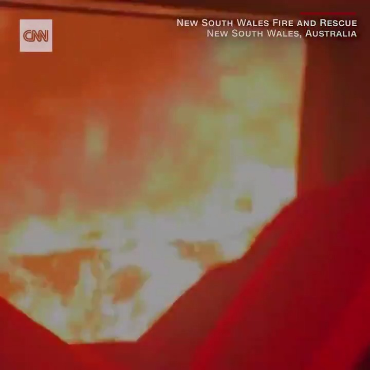 Dramatic footage shows firefighters driving through a bushfire in Australia as their truck is lashed by flames https://cnn.it/36dgQCv