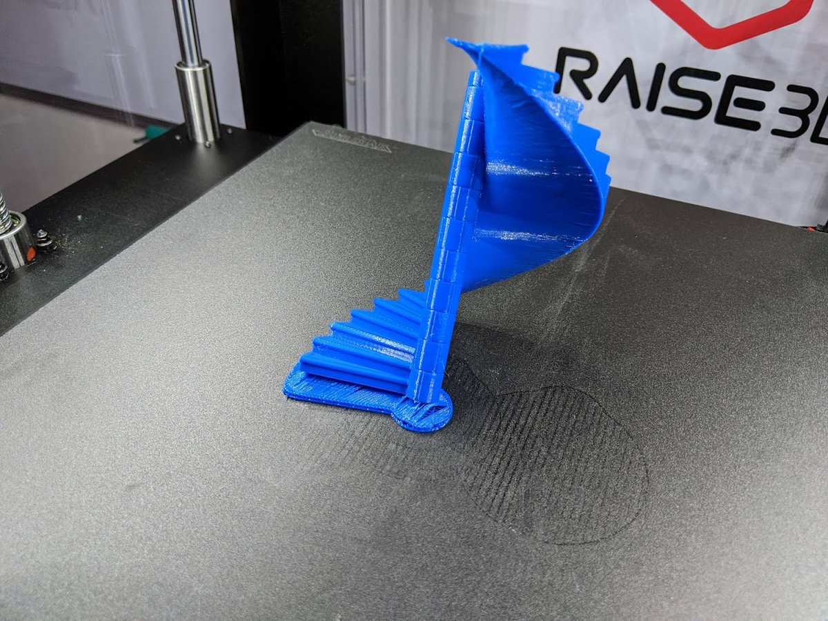 After cleaning away the carnage to investigate the crime scene I see where things went wrong... The @Raise3D Pro 2  had no problem perfectly printing the overhangs of each step. The #eSun PLA filiment I used adhered to the bed with kungfu grip.