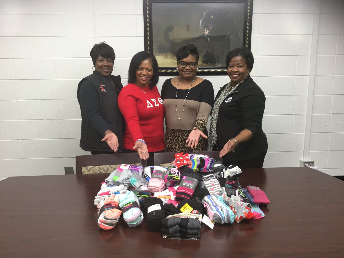 """13 Days of Delta Service Event—  """"Socks For Courtney""""Day 2/Part 2: In addition to making a presentation to the Rotary Club, HAC presented Mrs. Alneata Kemp with socks collected for the Socks For Courtney Campaign.#HAC1987!#DST1913 #DST107 #JoyInOurSisterhood #ServiceInOurHeart <br>http://pic.twitter.com/EsQl1VQodR"""