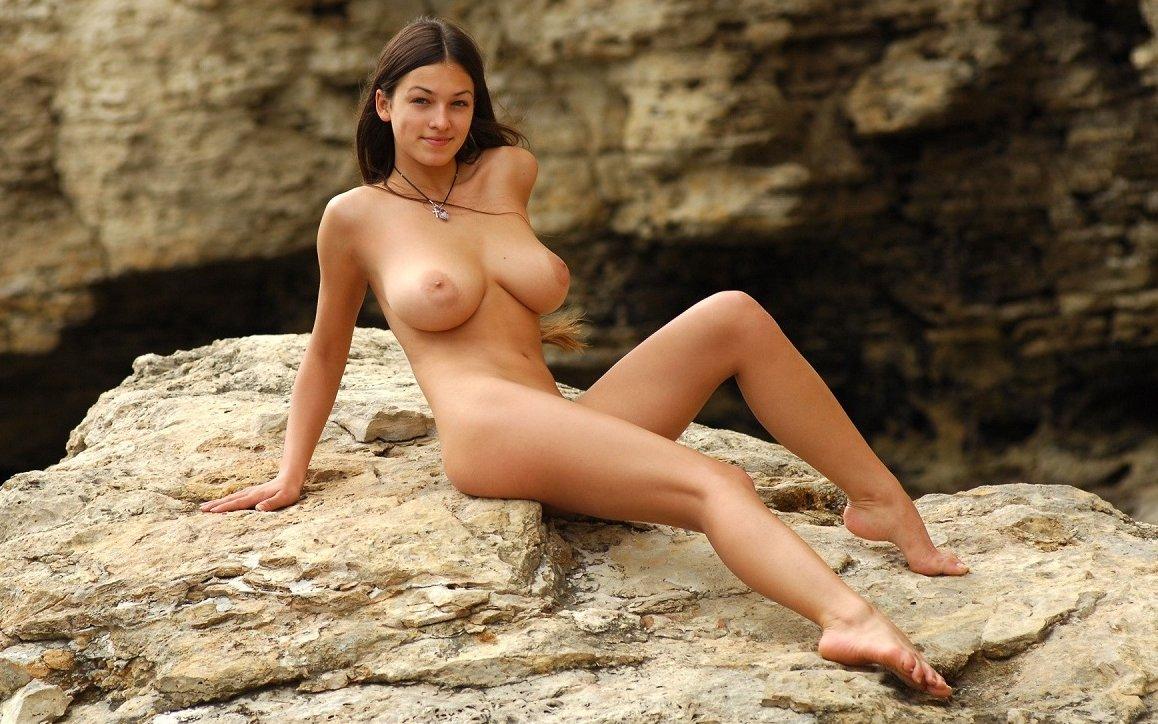 Girls pose topless