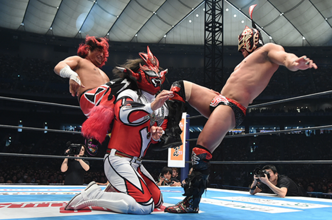 Ryu Lee and Hiromu Takahashi attacking Jyushin Thunder Liger During their Tag Team Match