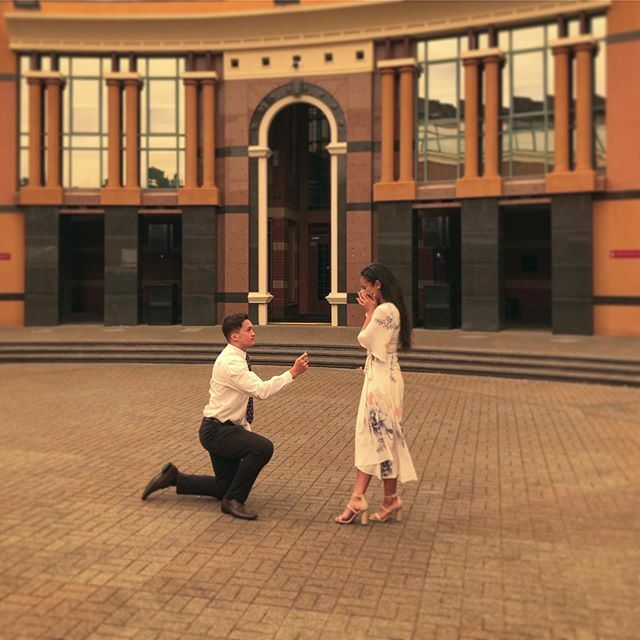 """Ariki Osborne proposed to Matterson Palaone yesterday at FSY New Zealand in the iconic bicentennial courtyard.  Ariki said """"The first time I met Maddie was as a youth at FSY... and she ignored me all week""""  She interrupts him saying """"I just didn't want t… https://t.co/K1cwwZ6mi6 https://t.co/DcI6PcKXut"""