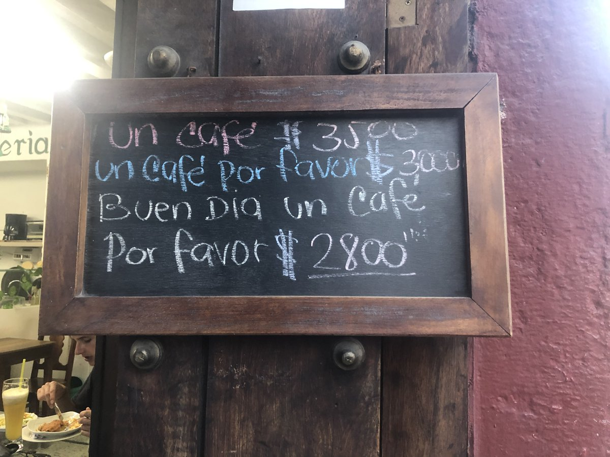 Politeness pays! Emotionally intelligent signage -- and dynamic pricing -- at a cafe in Cartagena, Colombia.