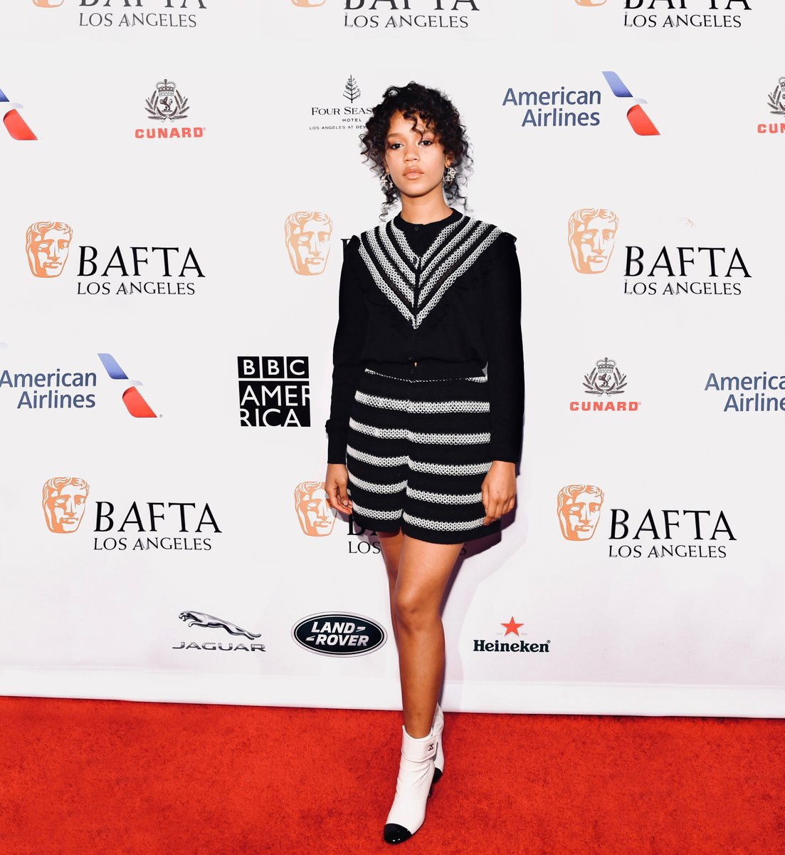 Friend of the House Taylor Russell attended the annual BAFTA TV Tea Party in Los Angeles in a black and white cardigan and shorts from the Spring-Summer 2020 collection. #CHANELinCinema #CHANELSpringSummer #EEBAFTAs