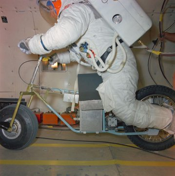 Closeup of the electric motor scooter with an astronaut during testing.