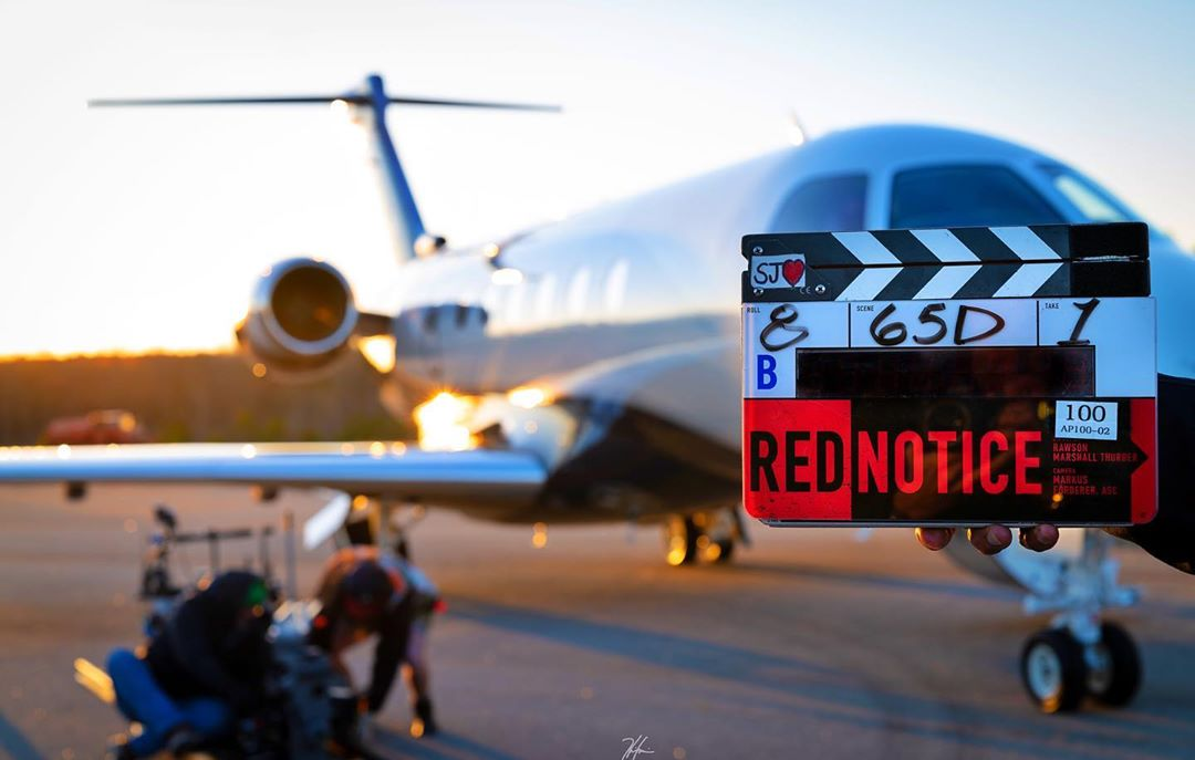 Netflixs Red Notice starring The Rock, Gal Gadot, & Ryan Reynolds has begun filming 🎬 On the run from INTERPOL, the movie brings together the worlds greatest art thief, tracker and conman (via @TheRock | Instagram)