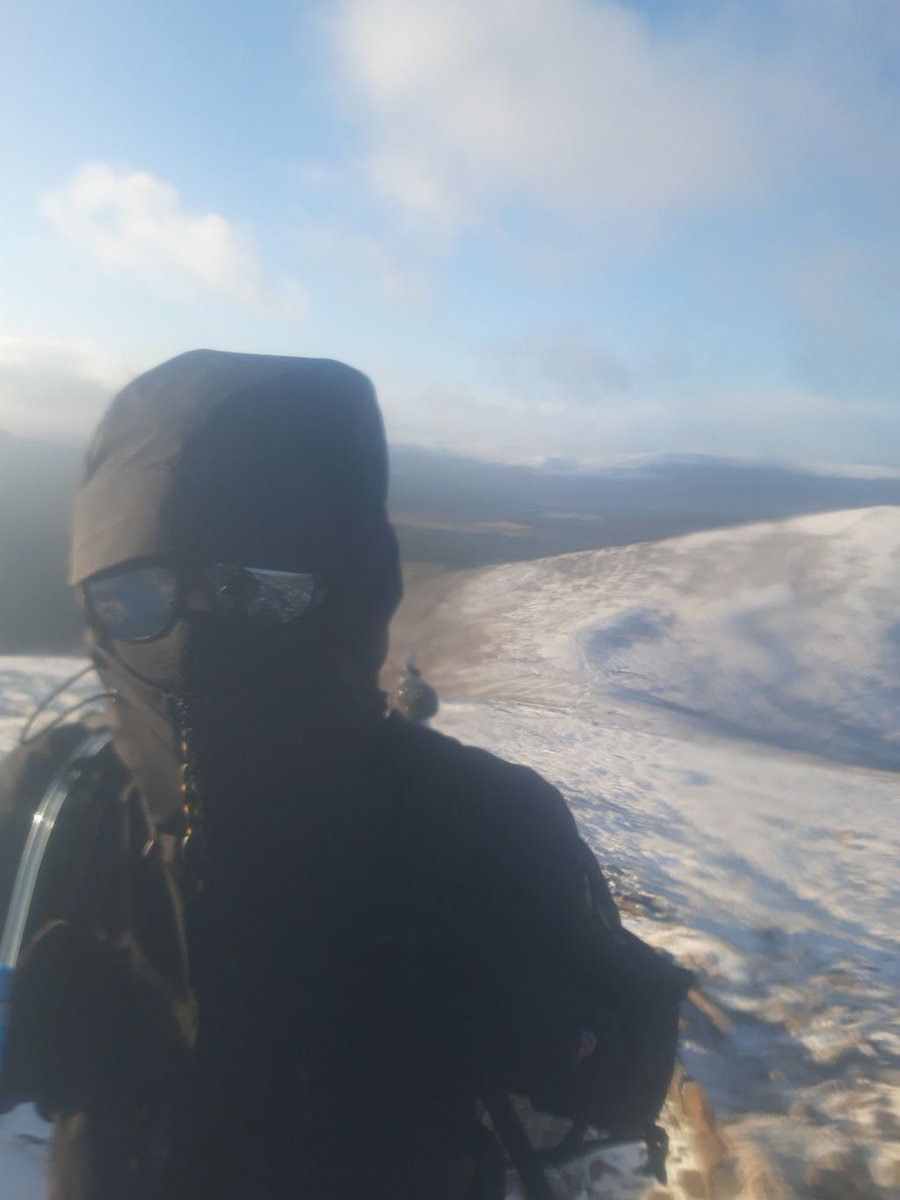 A very cold Tom atop a hill in the cairngorms here! We had planned on having a rest at the top, but a stiff cold wind forced us to move on sharpish!  Interested in having your own adventure? #guidebase can help.  #hillwalking #UKscrambling #mountaineering #climbing #adventure