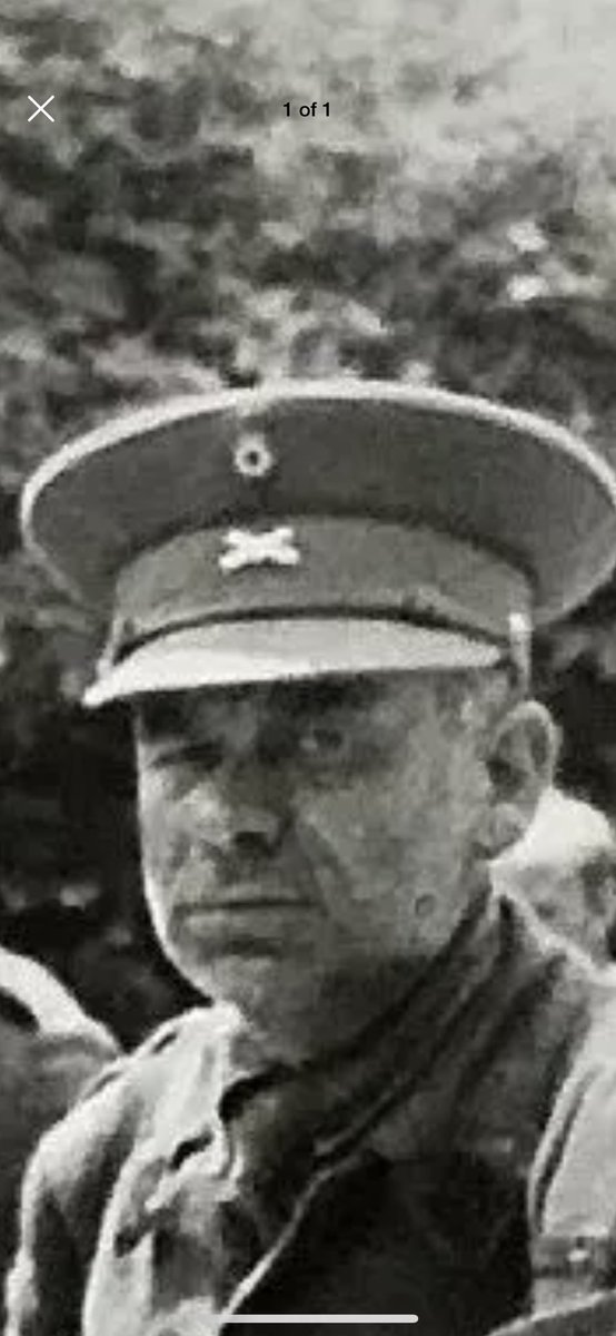 Anyone out there able to ID this cap badge? British POW photographed in Normandy 1940.
