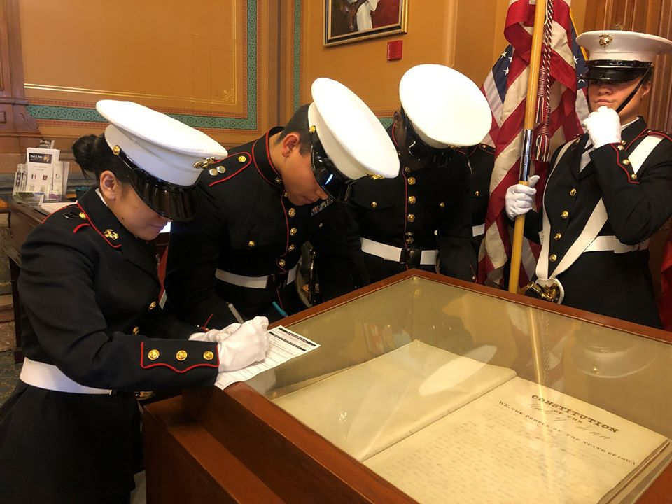 After participating in #Veterans Day ceremonies at the State Capitol, JROTC students from @DM_North High School visited our office & registered to vote, on top of the original Iowa Constitution. Congrats to all! #BeAVoter @DMschools