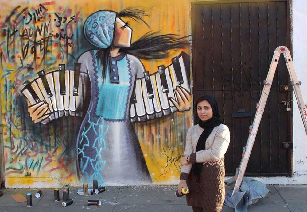 Shamsia Hassani, first known female graffiti artist in Afghanistan aims to create a strong voice for women through her art #womensart <br>http://pic.twitter.com/oYBXnxlGh2