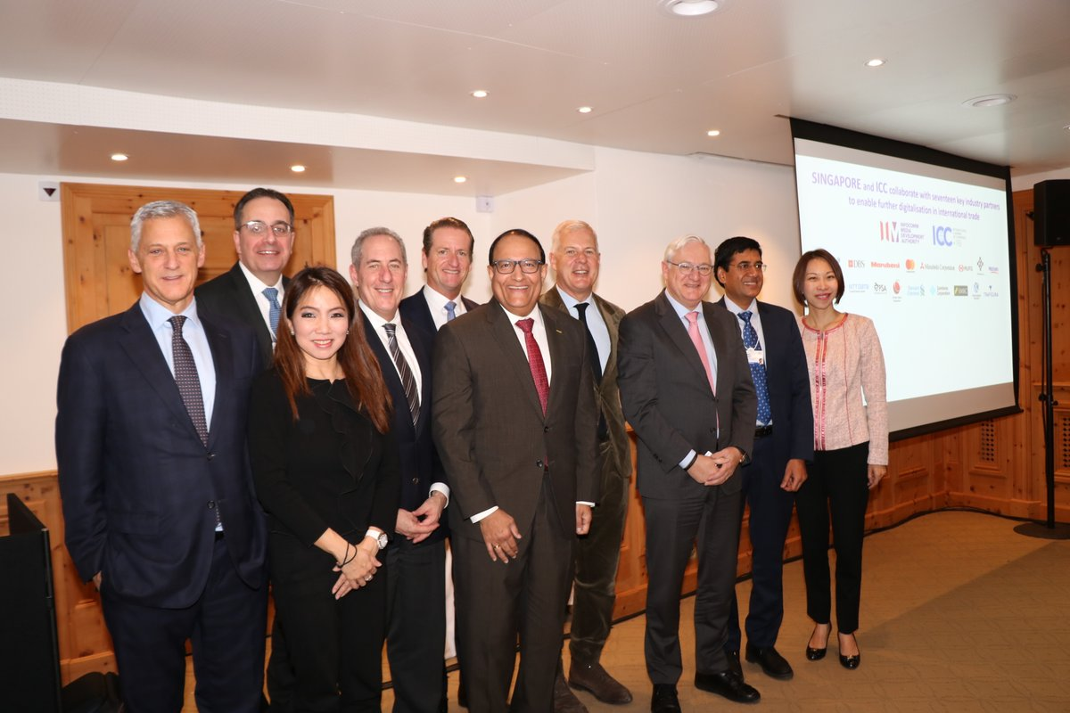 Singapore's Minister for Communications and Information S. Iswaran (centre), @Trafigura CFO, Christophe Salmon (second from left), and global industry leaders at the signing of the historic agreement with the Singapore Government and @iccwbo to facilitate and accelerate adoption of digital technologies in #trade and #commerce at #wef20 in #Davos.