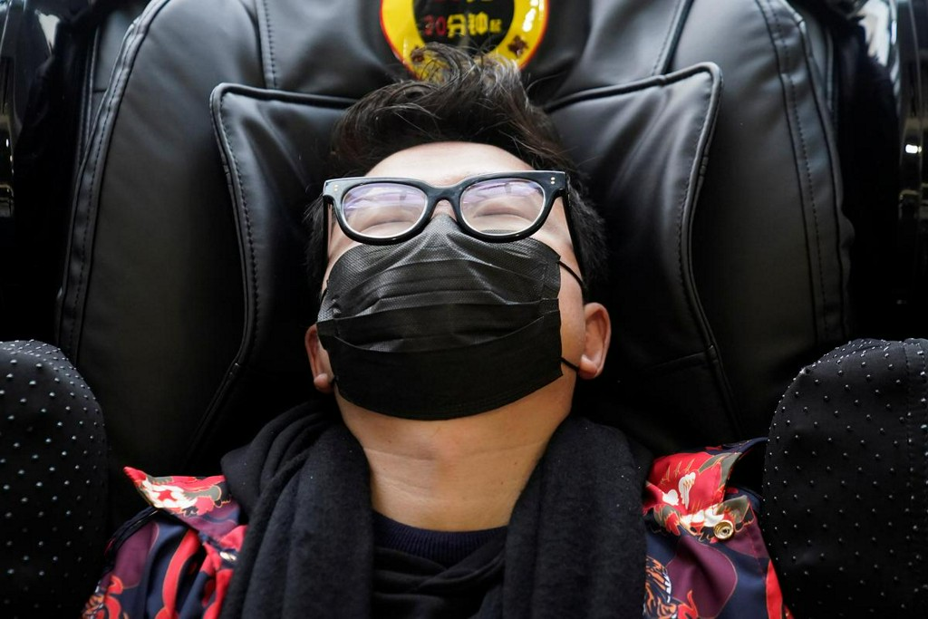 China's mask makers cancel holidays, jack up wages as new virus spurs frenzied demand