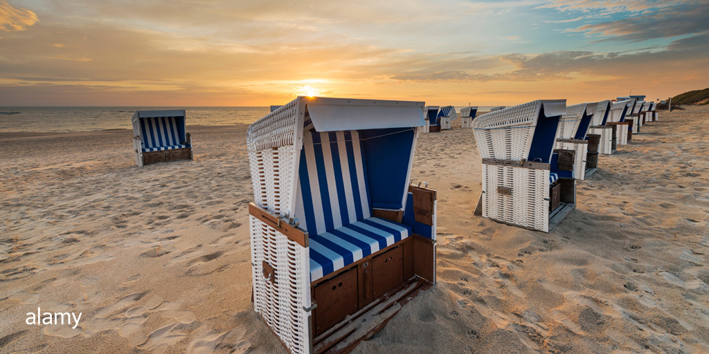 Sandy beach with beach chairs at sunset.  Image ID: TAC55C // Westend61 GmbH / Alamy Stock Photo  This beautiful image captures the light and colors of a tranquil evening at the beach.  #photography #atmosphere #tranquil #eveninglight pic.twitter.com/v6mNHDy31Z