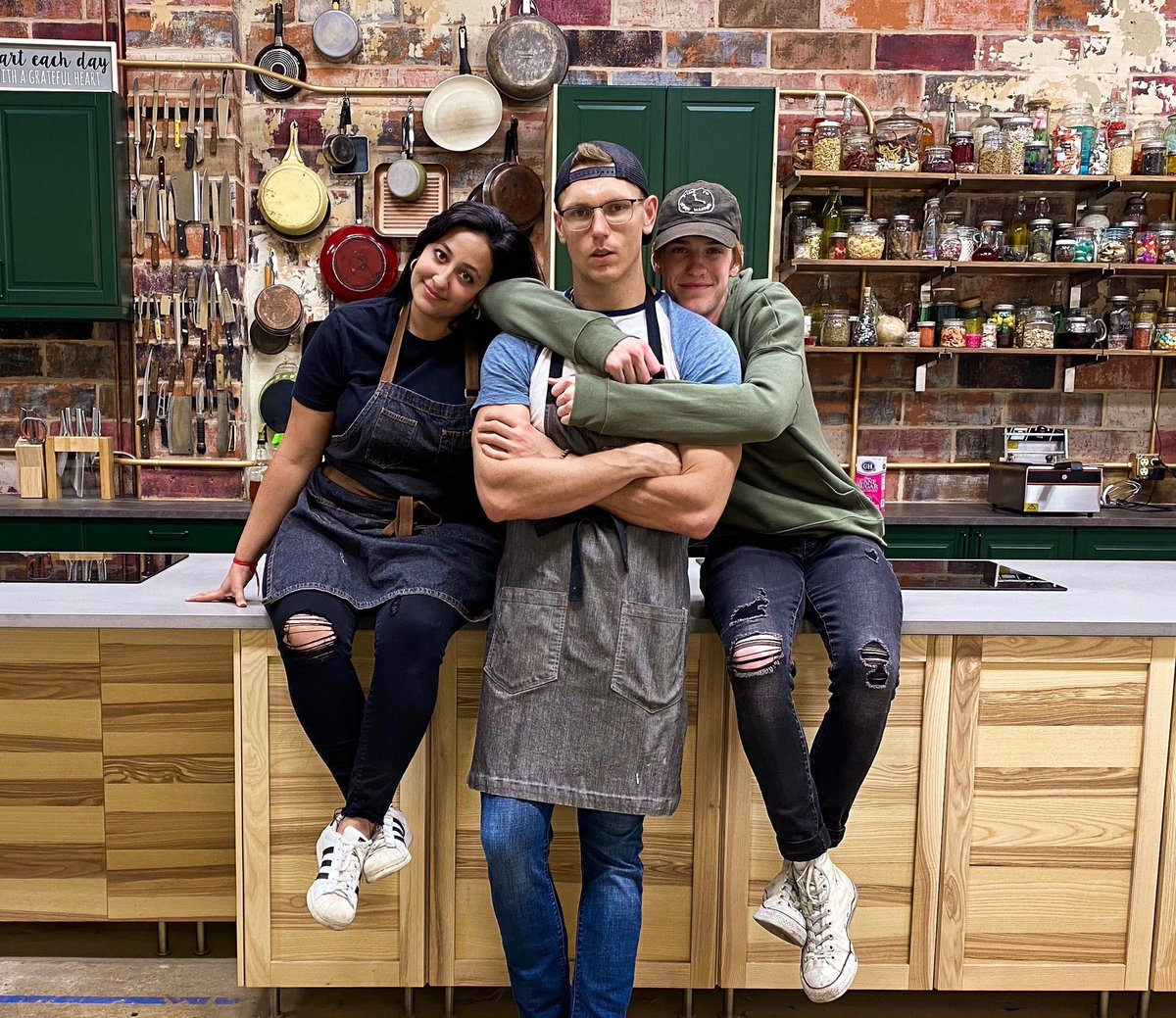 The Mythical Kitchen Staff posing in their studio