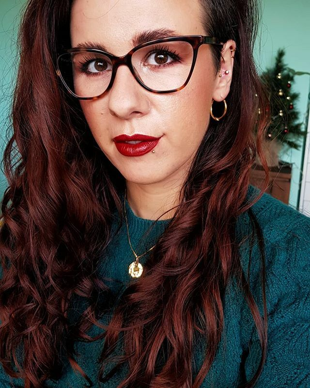 An ode to red hair and red lipstick. . This was from a bit ago, before I took the Christmas tree down from my background, but it really reflects me so here it is.  Lipstick is @mulaccosmetics Dark Heart from their latest Sassy collection. Sweater is from… http://bit.ly/35UPBvkpic.twitter.com/xlAKhI3J1n