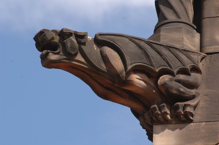A dragon-like gargoyle on the side of Edinburgh Castle