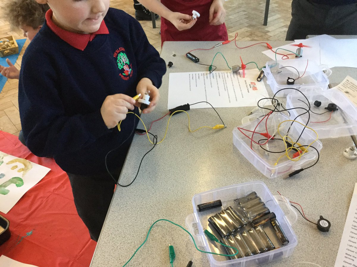 Experimenting with bulbs, wires and batteries.