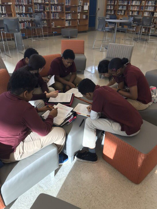 What focus! 7th grade scholars collaborating on central theme.