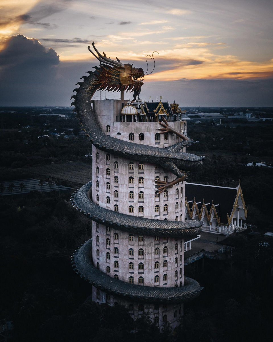 Its #AppreciateADragonDay, which is all the excuse I need to post these fiery photos of the incredible Wat Samphran Temple in Thailand. The dragon wrapped around the 16-story temple looks like its breathing fire in the sunset/ sunrise... #thursdaythoughts #FolkloreThursday #art