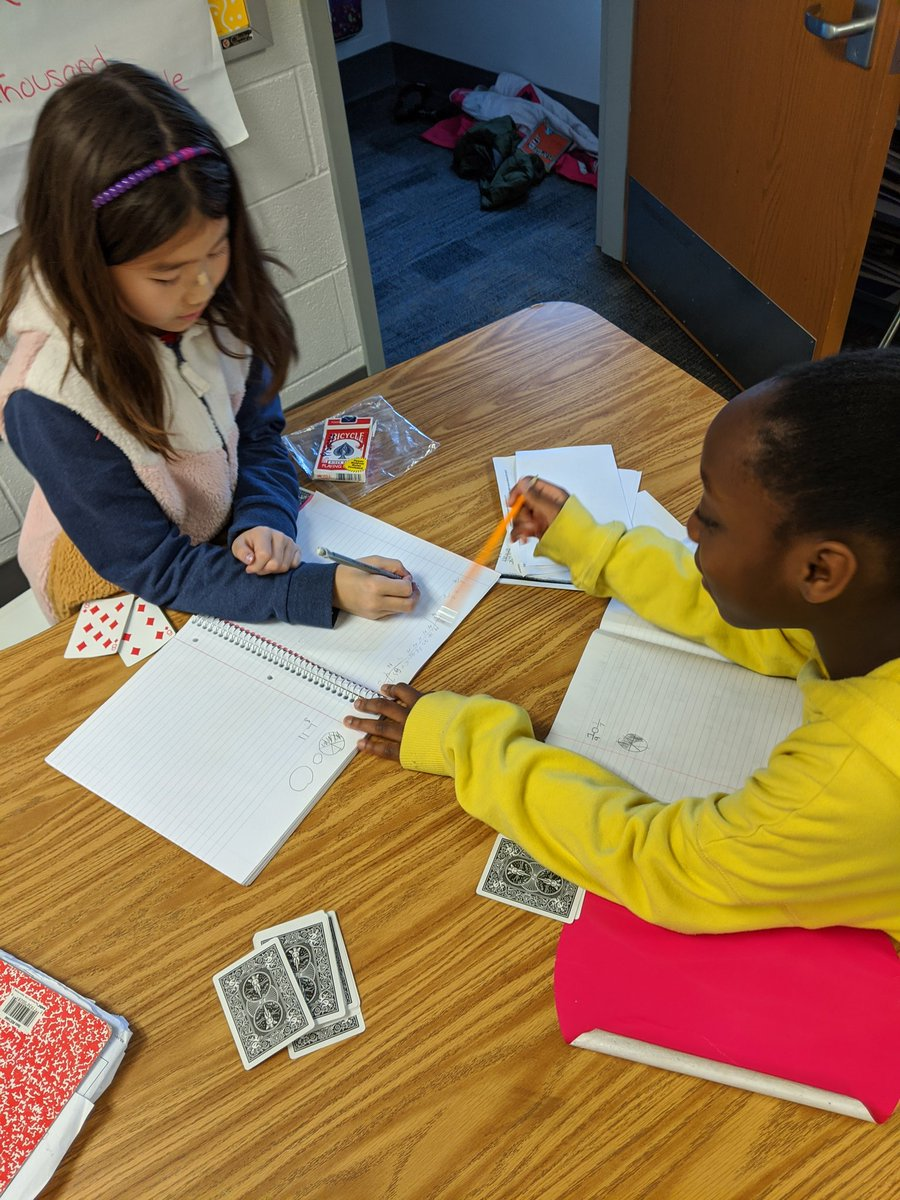 4th graders work on finding common denominators to compare and add/subtract fractions using card games and playing a version of
