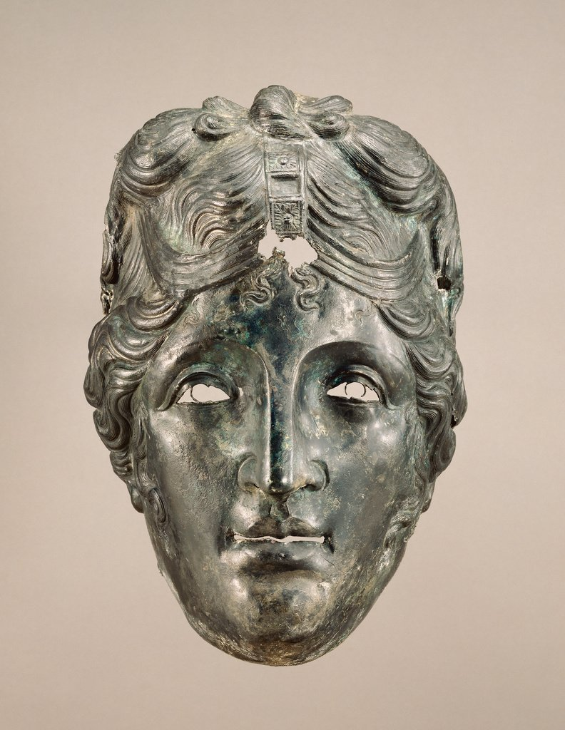 """This bronze mask from a Cavalry Helmet (A.D. 75–125) was used in the Hippika Gymnasia(""""equestrian exercises"""") by the Roman auxiliary calvary, the mask likely represents Aphrodite or Artemis, perhaps used in the re-enactment of a Trojan War scene-at Getty Museum. pic.twitter.com/jfYdXQPHiy"""