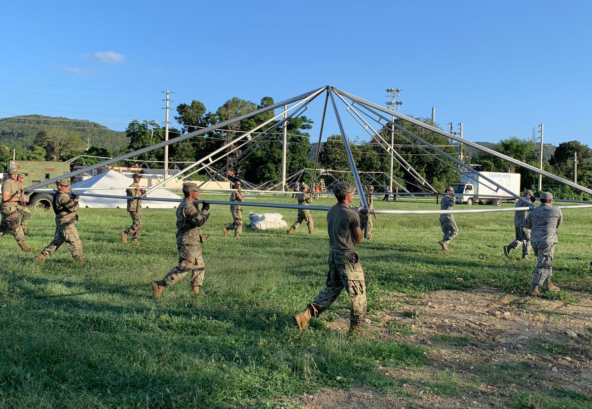 """Airmen with the Puerto Rico Air National Guard provide support at the """"tent cities"""" to support Task Force South and the displaced citizens affected by the earthquakes that shook the island in early January, 2020."""