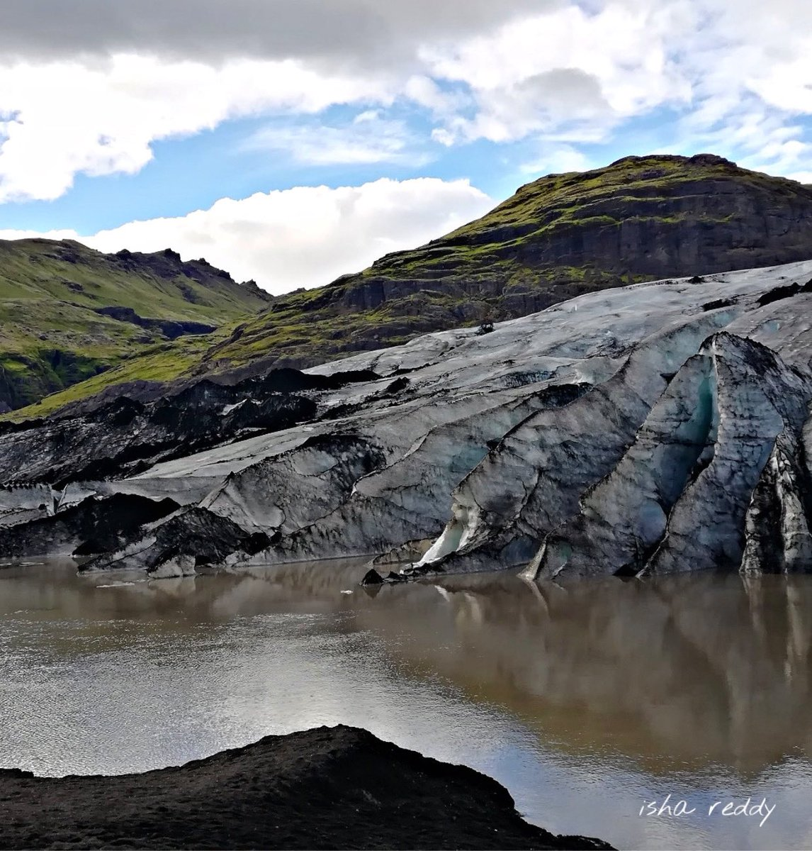 Iceland's breathtaking Sólheimajökull glacier. Did you know that this ash covered glacier sits on top of a volcano?! To know more about this amazing nation read The Fire Within Iceland https://amzn.to/2NgViOq  #Iceland #glacier #volcano #nature #beautiful #renewable #sustainable