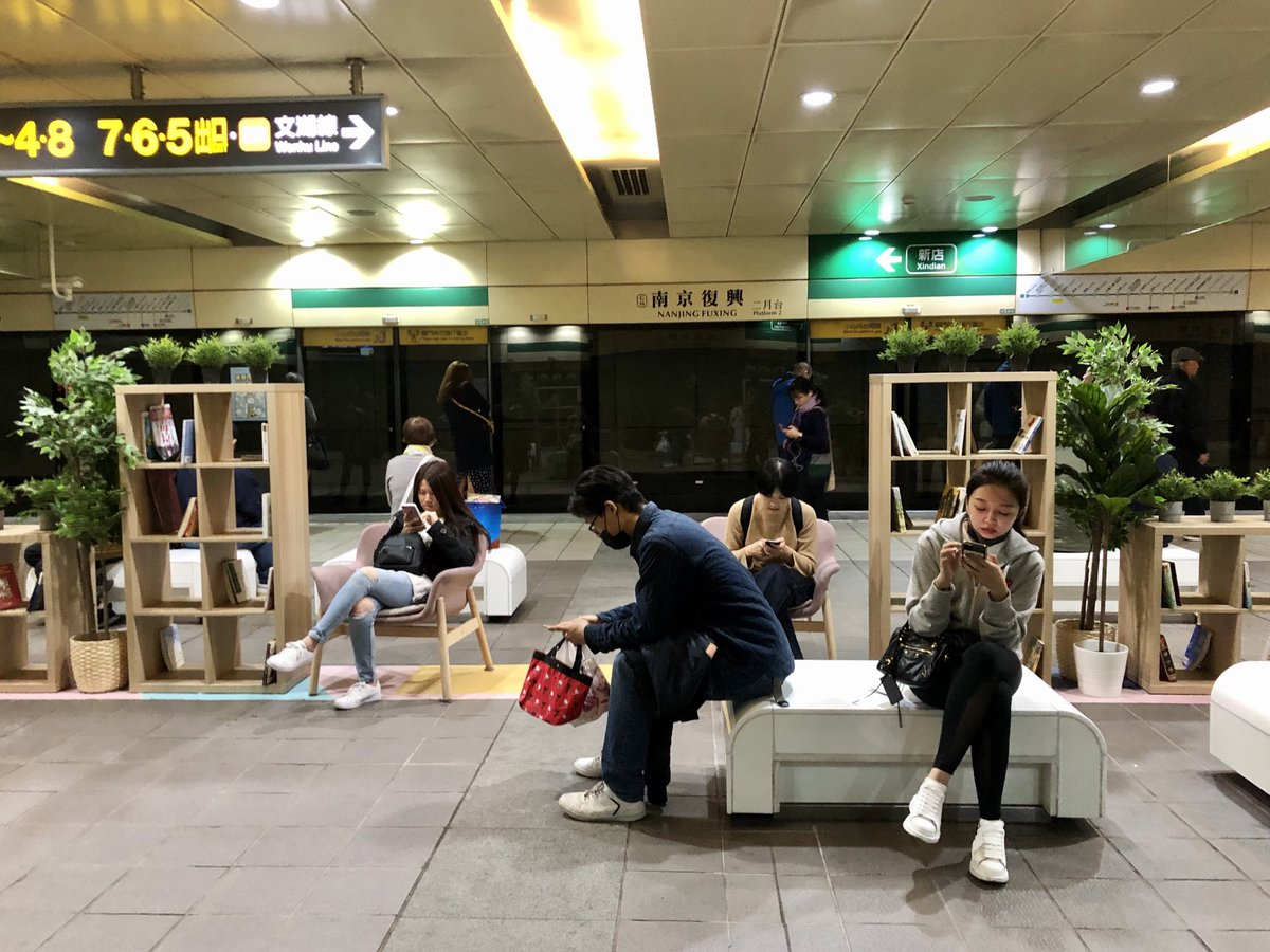 This is how people wait for the subway in Taipei. There's a pop-up library!