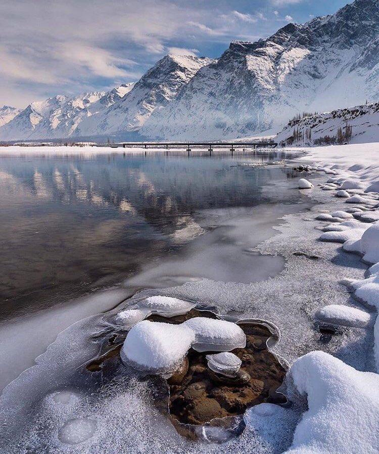 The frozen banks of Indus River after the heavy snowfall. Background is the new bridge towards planned New Skardu City #Skardu #GilgitBaltistan #WinterWonderland #Snow #FridayFeeling