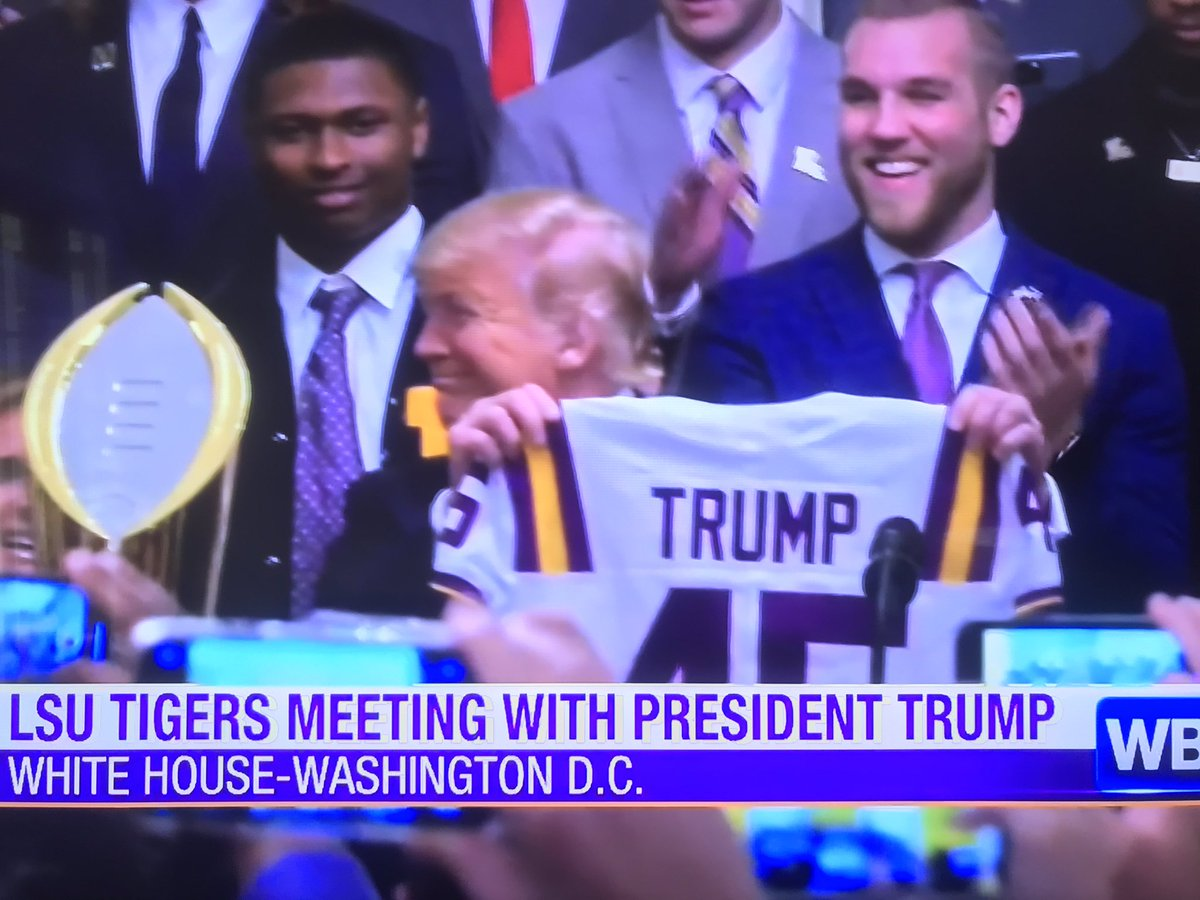 """Joe Burrow hands President Donald Trump an #LSU jersey.  Trump: """"I thought he was giving me the Heisman Trophy. He's just giving me a jersey."""""""