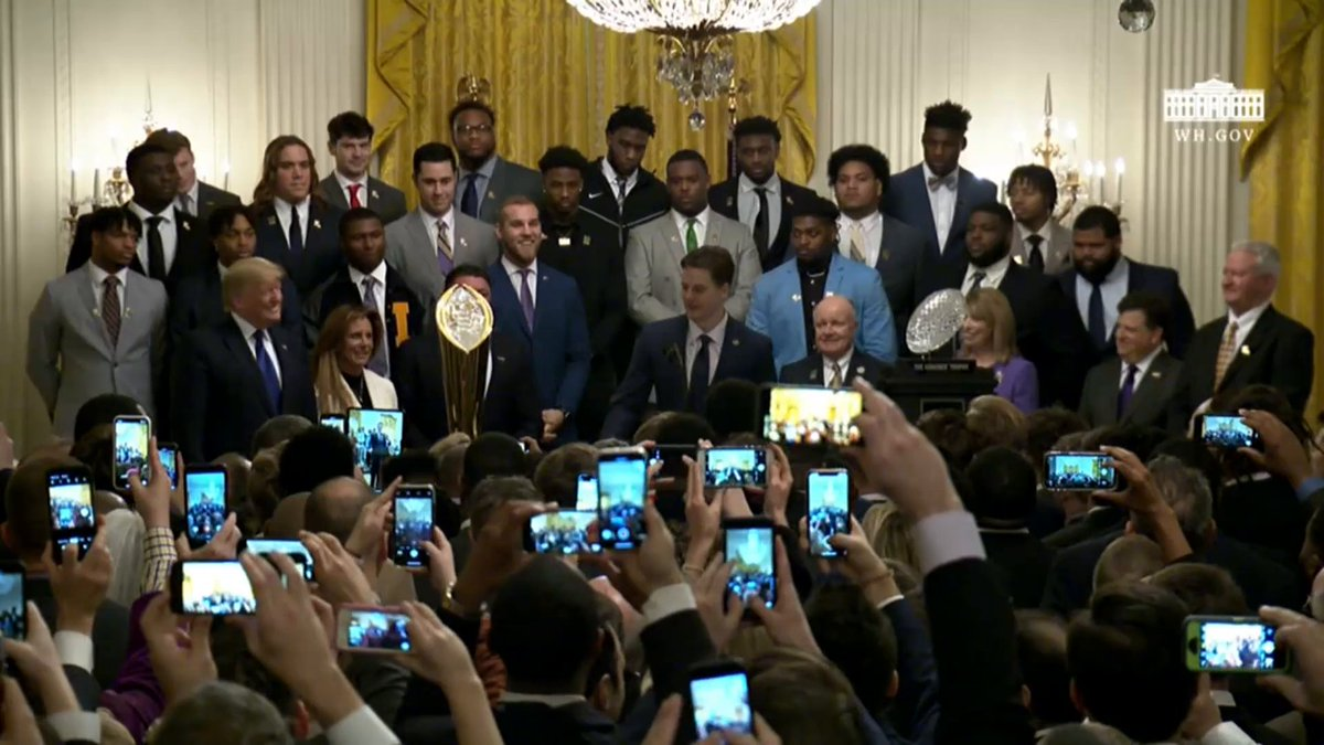 Quarterback Joe Burrow presents an LSU jersey to President @realDonaldTrump!
