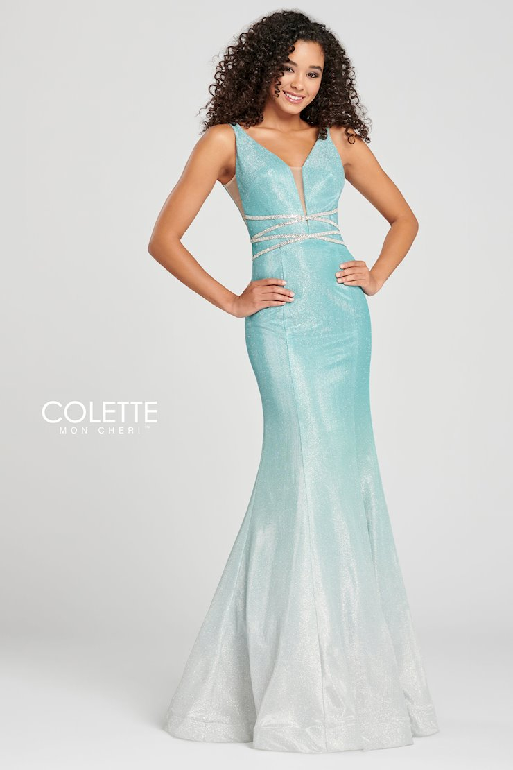 New Arrival!   Sleeveless glitter tulle trumpet gown with a plunging V-neck, crisscross jewel detail at the natural waist, open back and horsehair hem.  #whitelacebridal #coletteprom #prom #indianapa #promdresspic.twitter.com/lOBcF3b5BJ