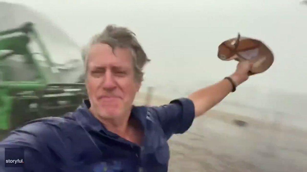 Aussie farmer celebrates long-awaited rainfall.