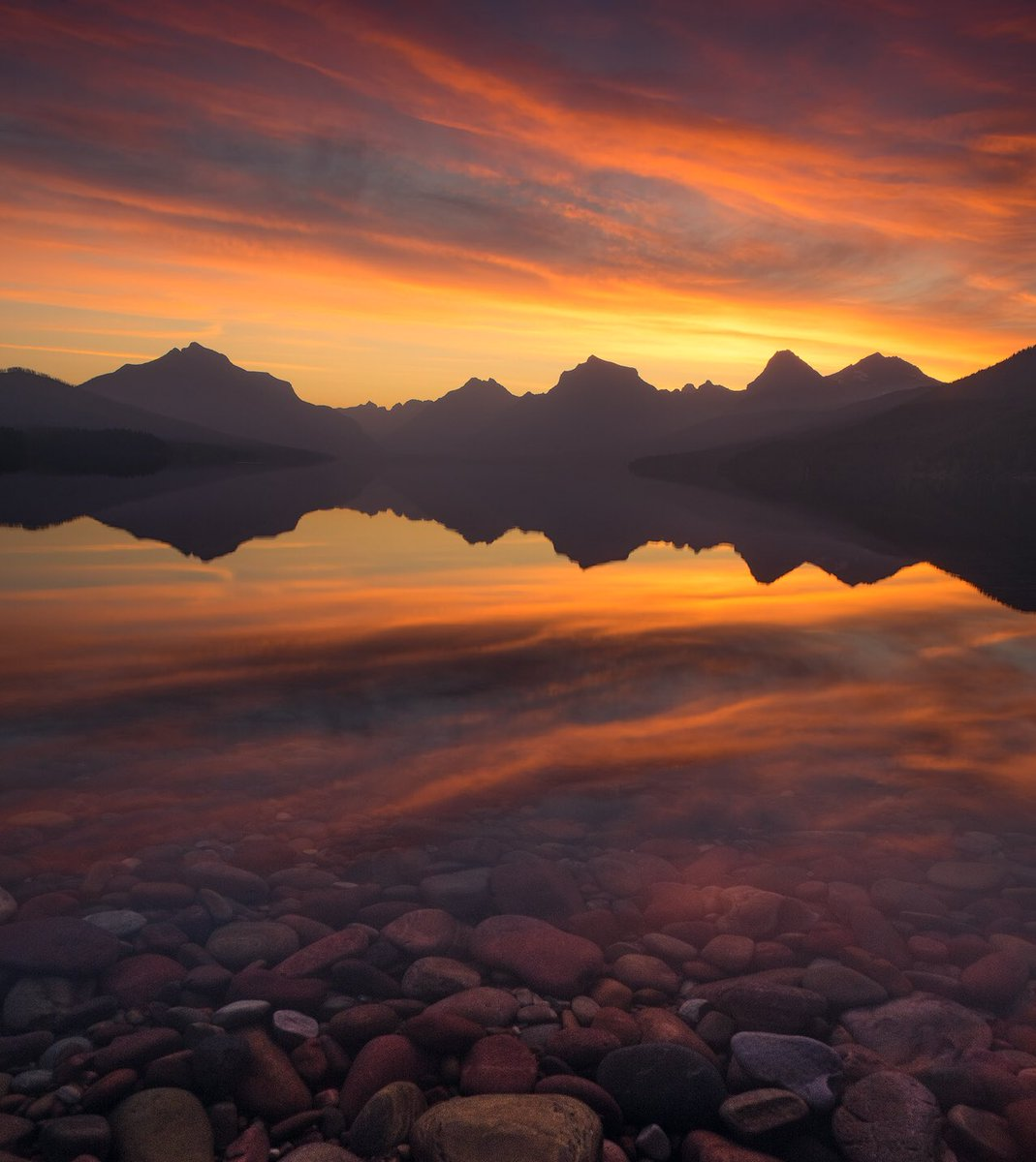 With mountains silhouetted against the sky, Lake McDonald @GlacierNPS reflects a briliant sunrise. Pic by Matt Meisenheimer (sharetheexperience.org) #Montana