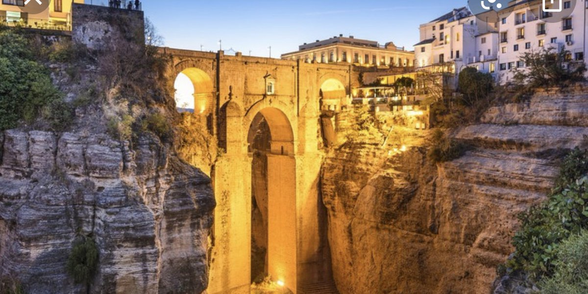 Me & Friend Joey(She's Hidden)Are In Beautiful  Arched Basement Of Church In Rhonda Spain. City Built Between 2 Mountains.Jail was in Bridge. 1 Guy Was Caretaker of Church's Son. In nite They Had Flamenco Singing  & Dancing. In The Day HOMEMADE🍷SANGRIA. IT TASTED LIKE PUNCH😱