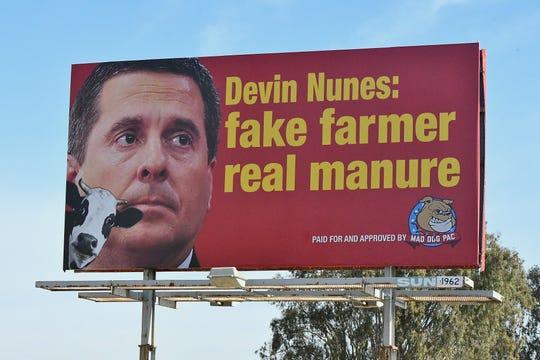 This is a REAL BILLBOARD in Central California, #DevinNunesMustResign #FakeFarmerRealManureNunes #VoteNunesOUT