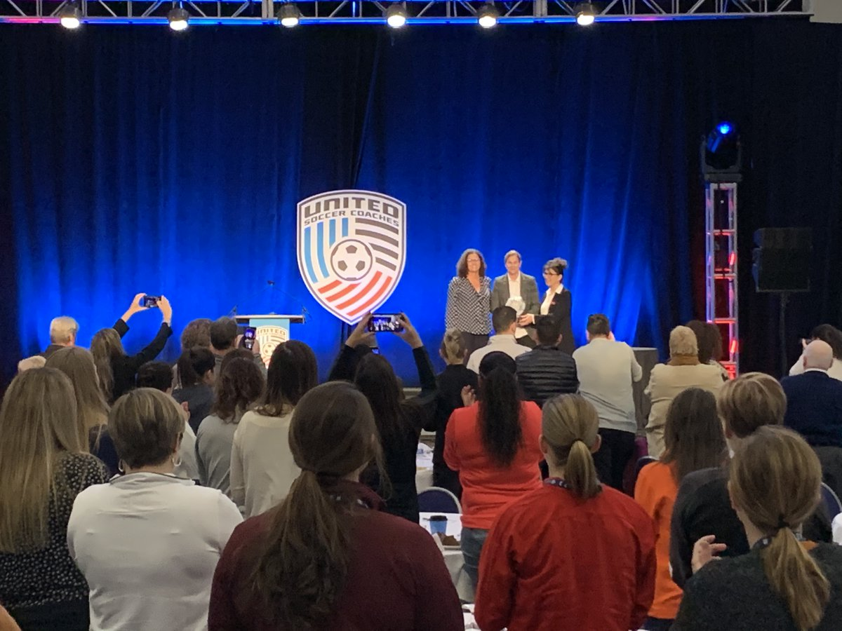 Jill Ellis receives a standing ovation as she is presented the @WAGSinsoccer Award of Excellence at #BMORE20
